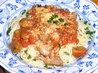 Vepřové po italsku na rajčatech se špagetami, sypané parmezánem a petrželkou