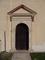 Kostelec nad Černými Lesy, portal kostela
