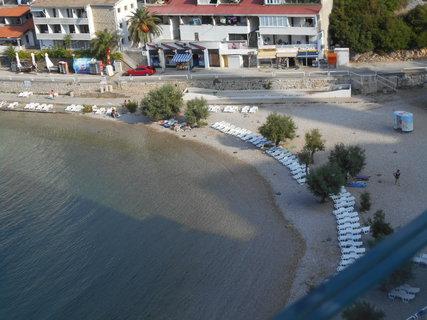 FOTKA - Pláž u hotelu po ránu.