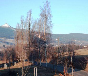 FOTKA - Ještěd v paprskách vycházejícího slunce /prosinec 2008/.