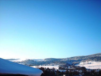 FOTKA - Zimní výhled z okna  / leden 2009 /  Ještědský hřeben.