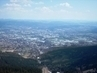 Výhled z Ještědu na dolní stanici lánovky,jížní část Liberce,prům.zonu Jih, Jizerské hory